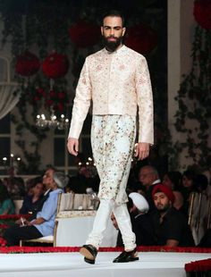 Model walking on the ramp to showcase Varun Bahl's floral motifs at AICW 2015. #Fashion #Style #Handsome #AICW2015 #Menswear