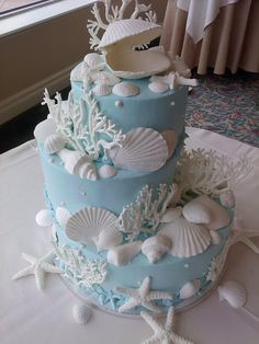 Seashell wedding cake, stagger-stacked making a unique presence. Made by Ye Olde Pie Shoppe, 732-530-3337 for a free consult.