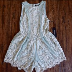 FOR LOVE & LEMONS Romper Lace Embroidered Jumpsuit Size Medium. New With Tags. $268 Retail + Tax.   Mint green and white lace romper with eyelash trim and hidden back zip. Fully Lined.  Authenticity guaranteed.   Cotton, nylon, rayon, polyester, spandex. Imported.   True to size.   ❗️ Please - no trades, PP, holds, or Modeling.    Bundle 2+ items for a 20% discount!    Stop by my closet for even more items from this brand!  ✔️ Items are priced to sell, however reasonable offers will be…