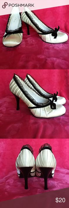 Satin with velvet trim heels ECU satin with velvet trim heels. Ivory color with black trim. Wore once for a few hours. Very comofortable! Ellie Shoes Heels