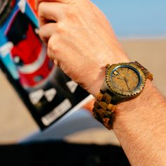 It's always Time for some reading on the beach. ENVY wooden watch. www.abaeternowatches.com #wood #woodwatch #summer #fashion   #watch #watches