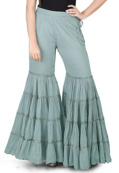 Cotton Mulmul Sharara Style Pant in Grey This readymade attire is designed with Dangles Do note: Top shown in the image is just for presentation purpose only. (Slight variation in actual color vs. Gharara Designs, Salwar Designs, Kurti Neck Designs, Kurta Designs Women, Kurti Designs Party Wear, Blouse Designs, Indian Fashion Dresses, Indian Designer Outfits, Fashion Outfits