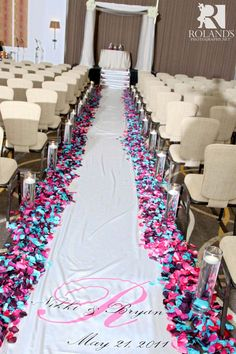 Wedding aisle flowers, love the pink and blue!