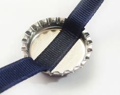 how to attach bottle caps to bows. - I need to try this with my inch buttons Bottle Cap Jewelry, Bottle Cap Art, Bottle Cap Crafts, Bottle Cap Images, Ribbon Hair Bows, Diy Hair Bows, Barrettes, Hairbows, Making Hair Bows