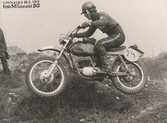 Vintage photo of a moto cross racer. (circa 1970)