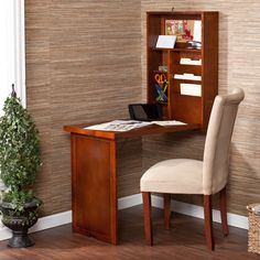 Transform a seemingly unassuming corner into a creative nook with this Murphy convertible desk. The wall mounted desk folds out to provide ample space for working, and folds up just as easily. Its inv