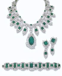 PROPERTY OF A ROYAL HOUSE: AN IMPRESSIVE EMERALD AND DIAMOND PARURE, BY HARRY WINSTON The fringe necklace designed with a detachable marquise-cut emerald weighing 38.48 carats and diamond pendant suspended from a series of rectangular-shaped emeralds within a vari-cut diamond lozenge-shaped surround to the brilliant-cut diamond double-garland necklace with circular-cut emerald detail, bracelet and detachable ear pendants en suite.