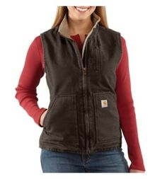 Carhartt - Product - Women's Sandstone Mock-Neck Vest/Sherpa-Lined. Our sandstone mock-neck vest provides the ultimate in workwear comfort and durability. It's made of 12-ounce, 100% cotton sandstone duck and is sherpa-lined for warmth. It also features a left-chest map pocket with a zip closure, two large sherpa-lined front pockets, two inner pockets and a drop tail for added coverage in back.