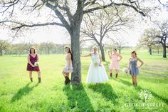 Mismatched bridesmaid dresses with matching cowgirl boots!
