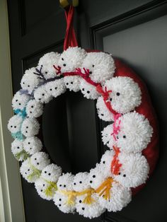 This item is made to order. This is the most adorable wreath ever made! Fifteen pom pom snowmen with rainbow scarves on a red ribbon wrapped 18 base. Red ribbon attached for hanging. Wreath is approximately 18 in diameter.