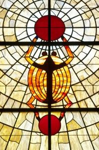 DeKalb, Illinois, scarab holding up the sun god in stained glass
