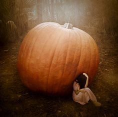 """My dad was a """"Miracle Grow"""" junkie.  This could have been me as a child--in our backyard one autumn--saying to myself:  """"Damn:  how many pumpkin pies does a 762 lb. pumpkin yield?""""  And:  """"Damn you, Miracle.Grow.Daddy for your mutant squash experiments.""""  ps:  Love you, Dad."""