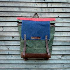 Waxed canvas backpack / rucksack with folded top and waxed leather shoulderstrap and bottom