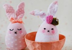 Supplies New newborn or baby cotton socks (You'll need one sock per rabbit.) Matching sewing thread Sewing needle Scissors Black embroidery floss (thread) A soft pink marker Pom-poms, ribbons…