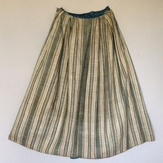 Lining - cotton & linen check woven in Holland. Blue wool tape waistband w/ brass hooks. Chinese Silk Damask Export.  Lining. For similar: http://museums.fivecolleges.edu/detail.php?museum=all&t=objects&type=all&f=&s=HD+2004.22&record=0 - banyan  http://www.christies.com/lotfinder/textiles-costume/a-court-mantua-of-chinese-imperial-yellow-5018370-details.aspx?from=salesummary&intObjectID=5018370&sid=6c0df234-920d-44ff-9d23-ddb9288ab8df - dress