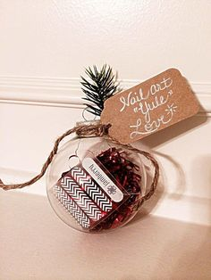 """Nail Art """"Yule"""" Love Ornament: Make 2 of these gifts out of 1 Sheet of Nail Wraps! Total cost for 2 Ornaments is only $9.75!  -Sheet Jamberry Nails Wraps: $15 -Plastic Fillable Ornaments: Michaels (Set of 4 for $2.49...they were on sale!) -Red Tinsel: Dollar Tree ($1 per Bag) -Pine: Dollar Tree (Cut off branch $1) -Twine & Gift Tag: Had on hand (can buy at Michaels)  www.10toes10fingers.com #nailart #teachergifts #holidaygifts #holidaynails"""