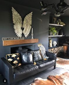 Eclectic, Dark & Glamorous Home Tour - Sally Worts | I adore the fact that the smallestamount of any colour, in a predominately dark style space, makes it sing louder than it would do ina more colourful setting and therefore has more impact. Less is more in this case! #eclecticdecor #darkinterios #interiorinspo #interiors #homedecor #electicinteriors #darkdecor #interiordesign #decor #interiorinspo #homeinspo #eclectichome