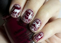 China Glaze Merry Berry from the Holiday Joy 2012 collection.  Stamped the holly and large snowflake Bundle Monster plate BM14 from the old collection. The moose is on BM-214 from the new Bundle Monster collection. The tiny snowflake is from MASH plate m50 and the lace pattern is on MASH plate m57.