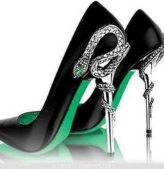 These black heels with a dollop of emerald green and snake detailing on the heel are so amazing.