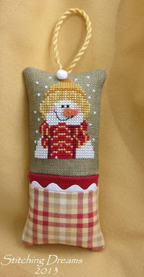 love the unique color combo on this cross stitched snowman pillow ornament