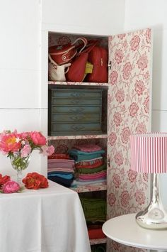 storage and beauty...papered...I adore the idea of papering the inside of the doors with something pretty!