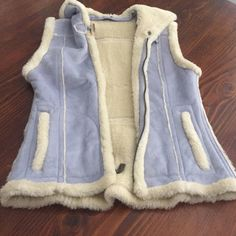 Sheep skin 💯SKEA vest in baby blue color! LUXURY Hello fancy snow bunnies out there!! This adorable blue sheepskin SKEA vest has your name all over it! Vest is in perfect condition. I bought this for a trip and did not even wear it. It did come with an extra skin flap that was attached to the neck but unfortunately I can't find that piece because I detached it from the vest since I did not intent to wear with it. (it is much cuter without it tho)! No stains, tears or marks!!!! Just…