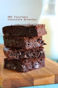 I replaced the flour with PB2 (powdered peanut butter) and created these moist, delicious brownies for under 135 calories each! #glutenfree