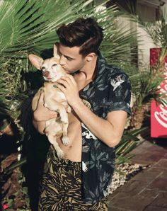 Cameron Dallas kissing a puppy