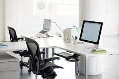 White Table and Aeron Chair that Monitors Accompanied by the Books were Laydown
