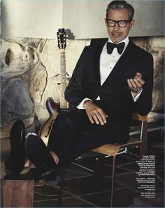 Starring in a photo shoot, Jeff Goldblum wears a shirt and tuxedo by Giorgio Armani. He also wears Ralph Lauren shoes and a Tom Ford bow-tie.
