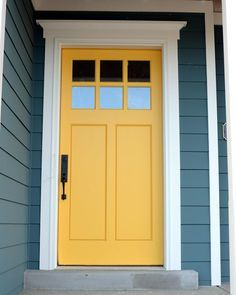 Your front door is the first thing that people see when they look at your home. The good news is that there are plenty of front door color ideas to choose from, so you'll… Continue Reading → Exterior Paint Colors For House, Paint Colors For Home, Exterior Colors, Yellow House Exterior, Exterior Door Trim, Cottage Exterior, Paint Colours, Wall Colors, Exterior Design