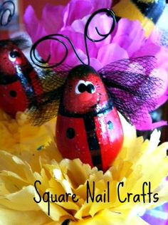 Ladybug hand painted by Square Nail Crafts on a C7 Christmas bulb using a Prim Chicks design.
