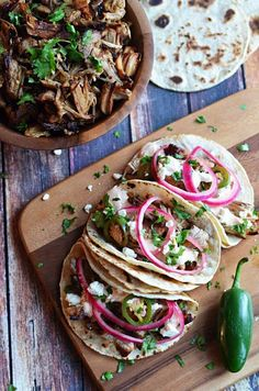 Slow cooker carnitas tacos recipe with chipotle cream.