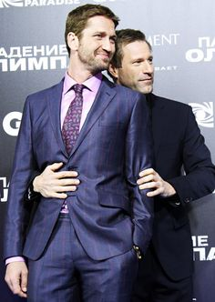 Hunk Sandwich Gerard Butler got a squeeze from costar Aaron Eckhart at the Moscow, Russia premiere of Olympus Has Fallen March 29.