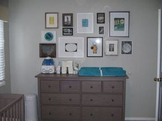 Possible dresser/changing table option from Ikea. Could change handle pulls to make it more interesting. Also like the photo gallery idea.