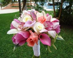 White & pink Cymbidium orchids, lilac & pink Calla Lily, pink Tulips, white & salmon Roses, soft & modern bride's bouquet.