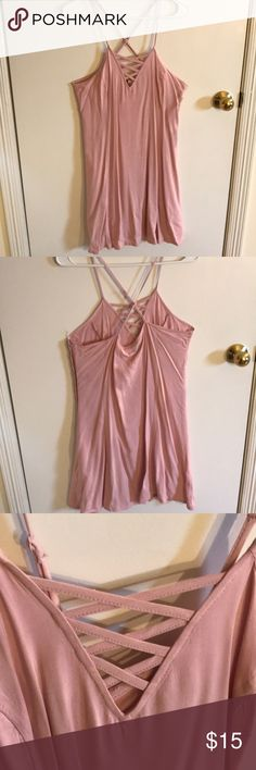 Casual summer dress Gorgeous baby pink dress perfect for casual occasions cross-back and cross cross design in the front for a more sexy look. Hard to see in pictures but flows well on and looks great! Never worn. Fits more like a size 10 H&M Dresses