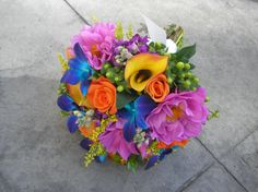 Multi-colored bouquets give off such a happy vibe and offer such a wonderful contrast to the white dress, it's no wonder more and more brides are choosing to venture into the world of vibrant bouquets!