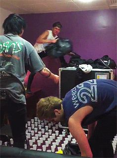 Hey Violet pranks 5SOS by covering their room floor with cups filled with water.