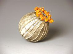 """Cathy Strokowsky ~  """"Tiny Golden Anemone"""" 2005, Blown, flameworked, sandblasted glass, artificial sinew, wire"""