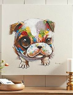 Delight your guests with the fun and whimsical Ollie Canvas Wall Art that features a flop-eared portrait and vibrant colors.