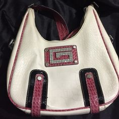 Guess Purse Bling bling!!! Guess purse on fire sale... Get it while it's still listed. Guess Bags Shoulder Bags