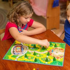 Enchanted Forest is a magical board game with a fairy tale theme. Players journey through the forest looking for the king's treasures under the trees along the way. Ages 6 and up.