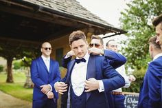 Groom wears three piece navy suit and navy bowtie | Photography by http://www.gemmawilliamsphotography.co.uk/