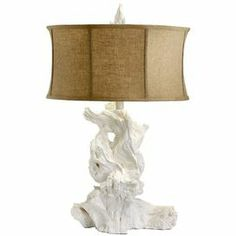 """Featuring a driftwood-inspired base and a cinched drum shade, this sculptural table lamp brings natural inspiration to your nightstand or hall console table.         Product: Table lamp  Construction Material: Plaster base with raw cotton shade   Color: White   Features:     Driftwood-inspired design  Adds organic appeal to any space        Dimensions: 30.5"""" H      Accommodates: (1) 100 Watt medium bulb - not included"""