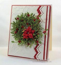 Poinsettia, pine and holly wreath