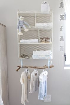 No nursery closet? No problem. We love the idea of a branch to display itty-bitty baby clothing! - Project Nursery