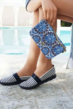 Grab and go with slip-ons and a cool printed pouch   Tory Burch Spring 2014