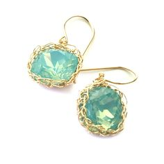 A Swarovski ocean green glass crystal crocheted around using yellow gold filled wire. A sweet pair of mint earrings. The Swarovski crystal has a lovely color, and together with its unique round - squa Mint Jewelry, Delicate Jewelry, Gold Filled Jewelry, Wedding Jewelry, Swarovski Crystal Earrings, Crystal Jewelry, Beaded Jewelry, Glass Crystal, Crystal Pendant