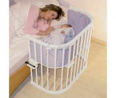 sidecar baby crib for co-sleeping. I like the rounded corners on this one, but there are many different designs out there.